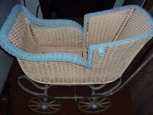 Antique full size wicker pram carriage for baby from early 1900