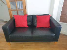 2 x Ikea Black leather 2 Seater sofas. Can deliver within local area