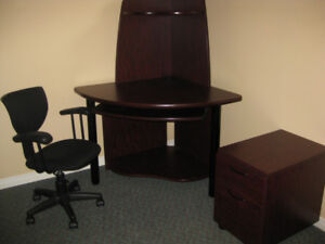 Corner desk with chair, bookshelf, and cabinet