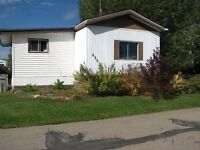 OWN THIS HOME FOR LESS THAN $1000/MONTH! WHY RENT?