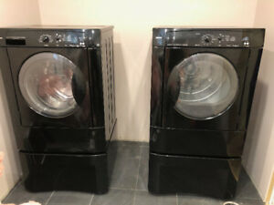 Kenmore front loading washer and dryer on pedestals