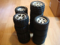 RC MINT TO ALMOST NEW TIRES & RIM TRAXXAS TMAXX, REVO, & OTHERS