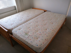 Single/ pull out double wooden bed.