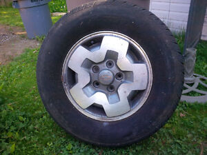 four tires and rims, 235/70R15