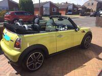 Yellow Mini Cooper convertible 59 plate