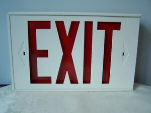 2 METAL LIGHTED EXIT SIGNS AND 2 WITH PLASTIC CASINGS see PHOTOS