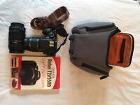 Canon EOS 550D (Rebel T2i) DSLR camera with 18-55mm lens and 55-250mm lens