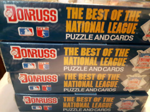 Collection of unopened baseball and hockey cards