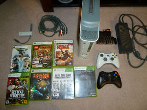 X-Box 360 with 2 controllers, 60 Gb Hard Drive, 18 games