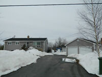 Updated Bungalow with Dbl Detached Garage and Paved Driveway