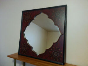 Mirror with decorative wooden frame