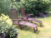TWO TEAK STEAMER CHAIRS WITH DETACHABLE FOOT RESTS
