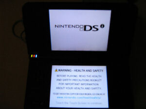 Nintendo DSI XL  and 12 games