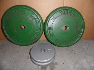 YORK WEIGHTS  - 2 x 25 LBS AND OTHER 2 x 5LBS