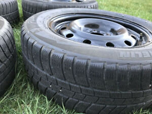 Michelin Winter tires 21560R16 used 3 seasons. With Rims