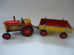 Vintage toy Zetor tin tractor with trailer