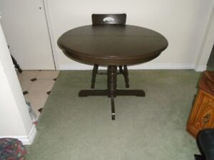Wooden pedestal table and 4 chairs