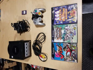 Gamecube with Memory Card. all cables and 3 Games