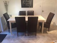 Table, 6 chairs and matching coffee table