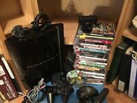 Huge PS3 Bundle (300gb hd upgrade,2 ctrls, 22 games, cam, fragnstein mouse,remote ctrl)