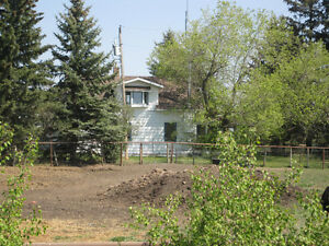 6.42 ACRES IDEAL FOR HORSES & 1.5 STOREY HOME!!