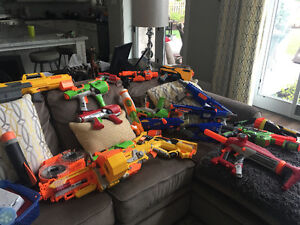 over 25 nerf guns and darts
