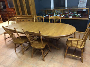 Solid oak table with Six chairs and a Buffet and hutch