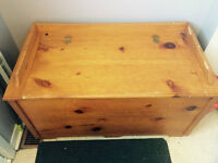 Nice hard wood coffee table, and pine wood chest.