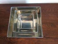 Set of 3 square cake pans.