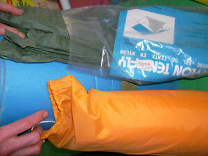 Tent in bag, tent fly, underpad as ground cover for sleeping bag