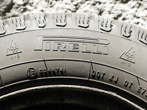 4 Pirelli Winter Carving 185/65R14 on steel rims w/wheel covers West Island Greater Montréal image 3