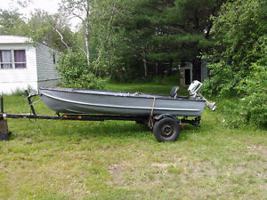 14 foot aluminum boat with motor and trailer.