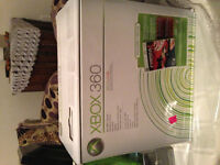 xBOX360+1 manette+chargeur+cable tv+4 jeux