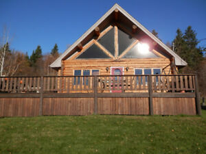Beautiful log home with amazing views just outside city limits