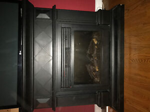 Black fireplace with built in speakers