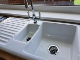 Ceramic / porcelain kitchen sink with middle drainer and mixer tap