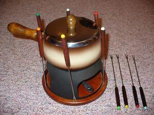 Steel and wood base fondue set