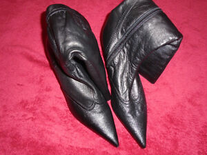 Brand new black leather boots , made in Germany.