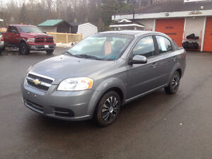 2009 CHEVROLET AVEO, CHECK OUR OTHER ADS, 832-9000 OR 639-5000.