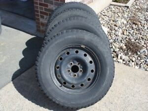 A set of Ford Escape winter tires and rims