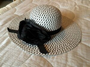 "Black and white ""floppy brim"" straw hat with black rose accents"
