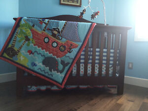 Baby crib with mattress and cover for the mattress