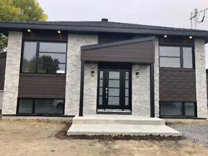 Magnifique maison neuve 5 1/2 à louer avec cour arrière 1200$/mo