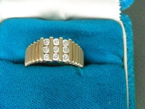 superbe bague pour homme 14kt a 9 diamants
