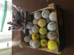40 assorted golf balls and bag of tees.