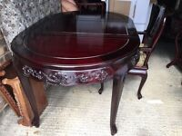 Rosewood extending dinning table with 6 chairs