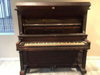 Upright piano full size.