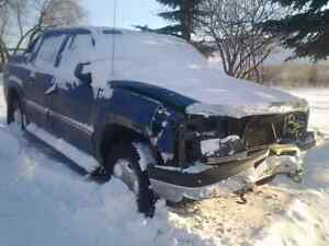 2003 and 2004 avalanche trucks wrecking