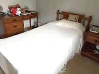 Single bed and bedside table with child's desk. Solid oak.