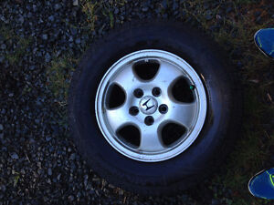 4 Michelin defender tires on rims(one brand new!)